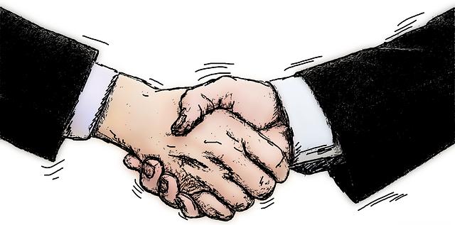 学会で新しい出会いを求める研究者たち